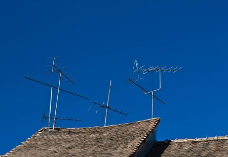 airwaves: Antennas on an old roof Stock Photo