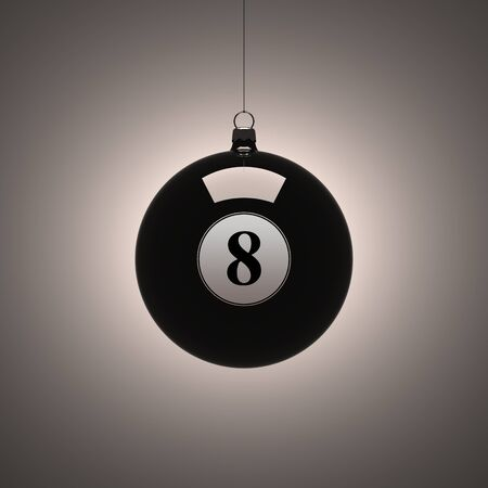Black billiard ball hanging as a Christmas decoration photo