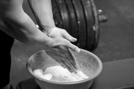 talcum: Closeup of hands of the weightlifter in talc Stock Photo