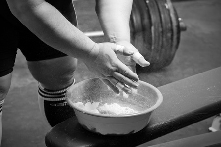 weightlifter: Closeup of hands of the powerlifter in talc Stock Photo