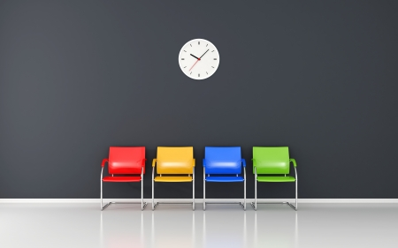 Colored stools and wall clock in the waiting room Imagens