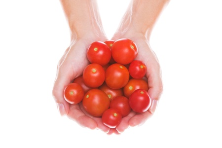 A lot of cherry tomatoes held in hand photo