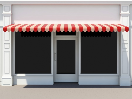 shop window: Shopfront in the sun - classic store front with red awnings Stock Photo