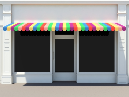 Shopfront in the sun - classic store front with colored awnings Imagens