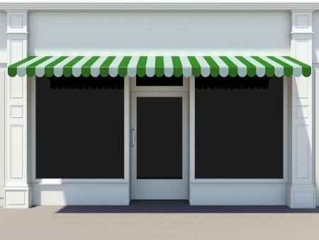 Shopfront in der Sonne - classic store front mit grünen Markisen