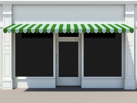 Shopfront in the sun - classic store front with green awnings photo