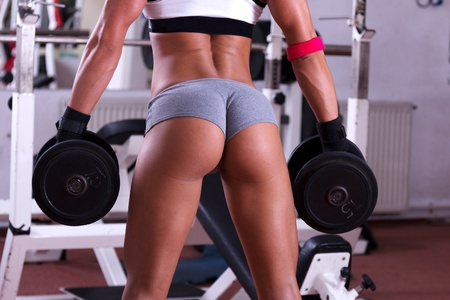 heavy lifting: Very sexy young beautiful ass in thong at the gym club