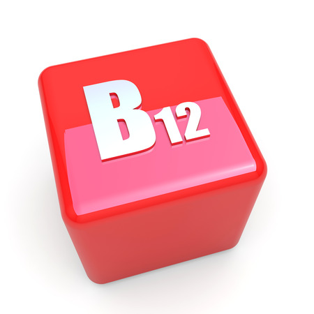 B12 vitamin symbol on glossy red cube