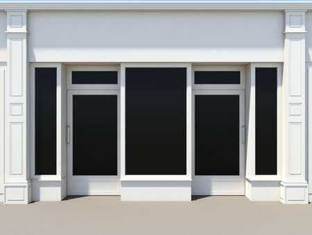 Shopfront with two doors and large windows. White store facade.