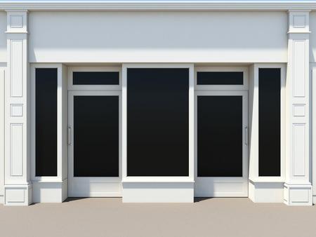Winkelpui met twee deuren en grote ramen. Witte winkel gevel. Stockfoto