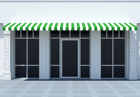 Shopfront in the sun - classic store front with green awnings