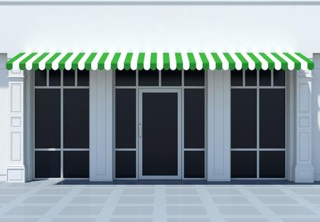 Winkelpui in de zon - klassieke store front met groene luifels Stockfoto
