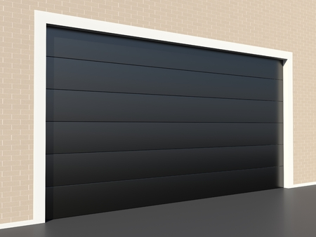 Modern black garage door on brick wall