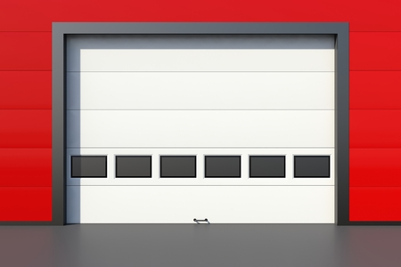 sectional door: Sectional industrial door with windows on red industrial wall Stock Photo