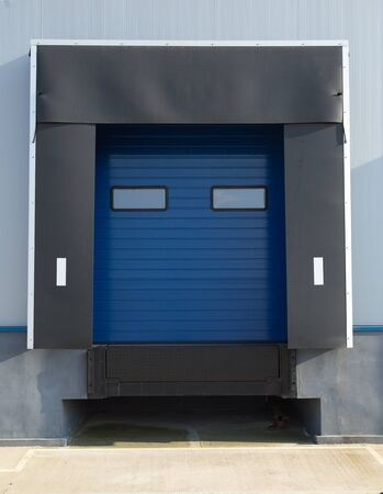 sectional door: Sectional industrial blue door with windows Stock Photo