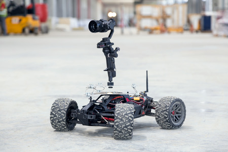 Dusty surveillance robot at industrial site Stock Photo