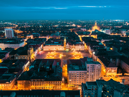 Nightscape of european city Timisoara seen from above by a drone at blue hour