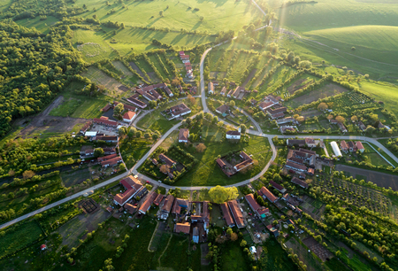 Beautiful unique circular village in Romania seen from above at the sunset by a professional drone with soft nice lens flare