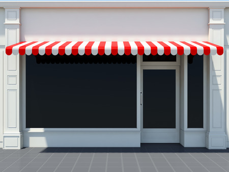 White shopfront in the sun - classic store front with red awnings