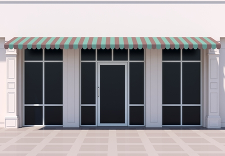 Classc shopfront in the sun - classic store front with awnings Stok Fotoğraf