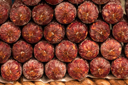 Homemade dry salami - traditional meat products, by smoked pork arranged in smokehouse Stock Photo