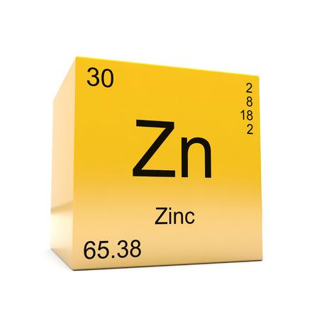Simbolo dell'elemento chimico zinco dalla tabella periodica visualizzata sul cubo giallo lucido Archivio Fotografico