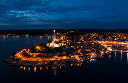 Beautiful Rovinj night aerial view taken by a professional drone from above the sea. Lights of the old town of Rovinj, Istria, Croatia Imagens
