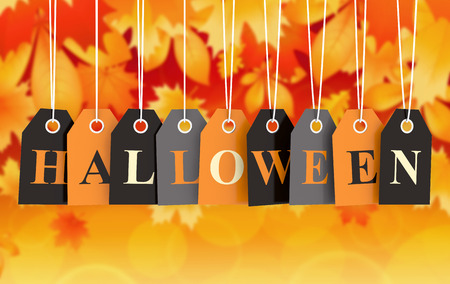 Halloween tag on colored hanging labels on orange autumn background