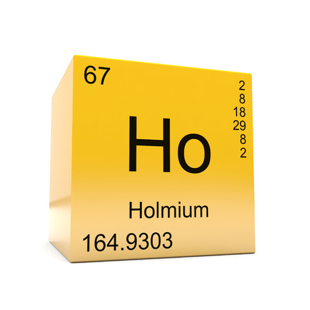 Holmium chemical element symbol from the periodic table displayed on glossy yellow cube