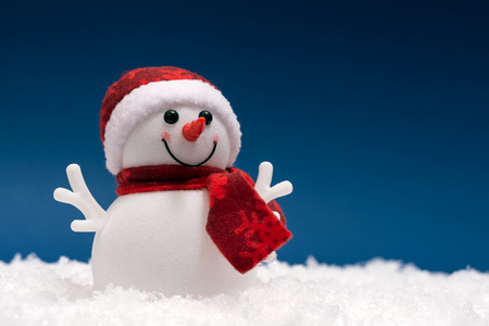 Happy snowman in the show on blue background