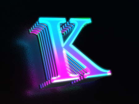 Beautiful colored glass letter K glowing in the dark