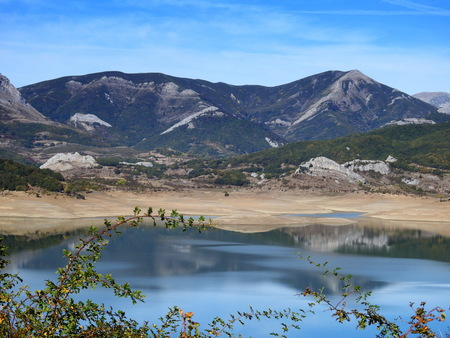 Reflections of the mountain over the water of the Porma reservoir