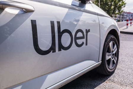 Warsaw, Poland - June, 2019: Uber logo taxi is seen on a white car Stock fotó - 128623031