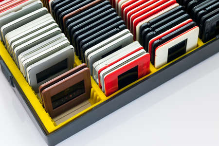 A collection of old slides in frames gathered in a box 스톡 콘텐츠
