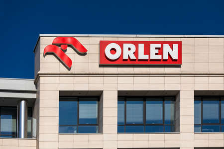 Warsaw, Poland - October, 2020: View on PKN Orlen - Polish oil company logotype on the top of building