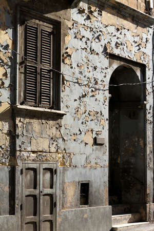 defects: An old facade with peeling paint
