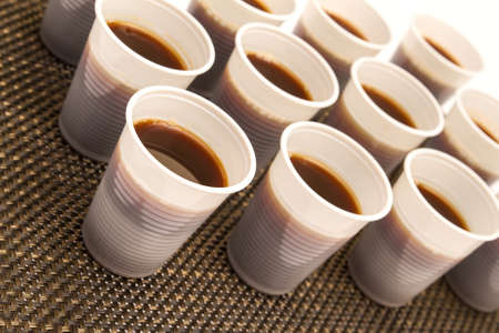 Lots of disposable cups with coffee  photo