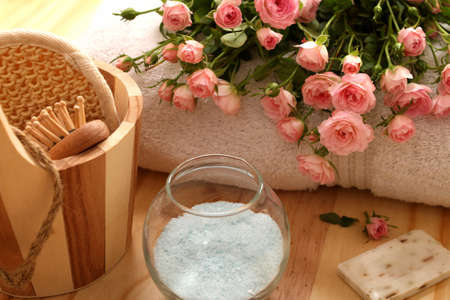 Roses, towels and spa accessories photo