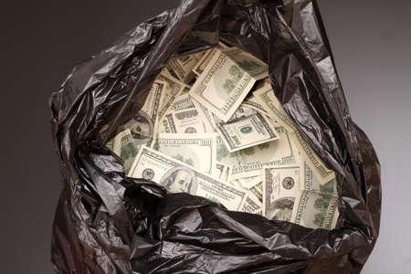 A Rubbish bag full of dollars  Foto de archivo