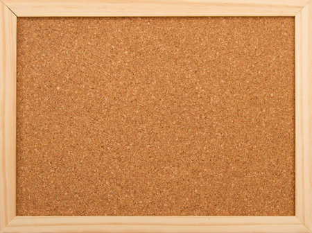 Cork board with a wooden frame.  photo