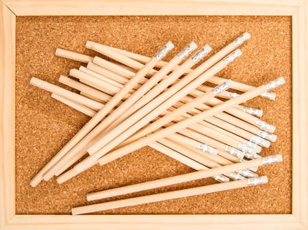 pinboard: Bunch of wooden pencils over a cork board