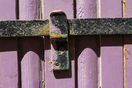 Old door with an iron bar background photo
