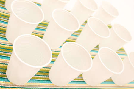 Lots of disposable cups on a colorful background  photo
