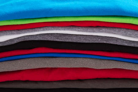 A pile of folded T shirts   Stok Fotoğraf