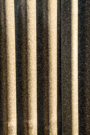 Corrugated metal with lights and shadows, background photo