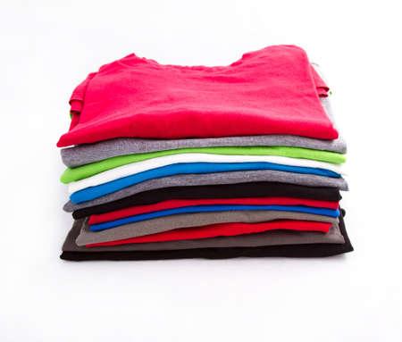 A pile of folded T shirts  photo