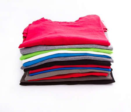 used clothes: A pile of folded T shirts  Stock Photo