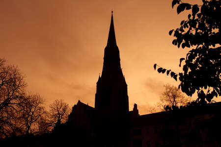 Silhouette of church dome in Berlin backlit by sunset colors  photo