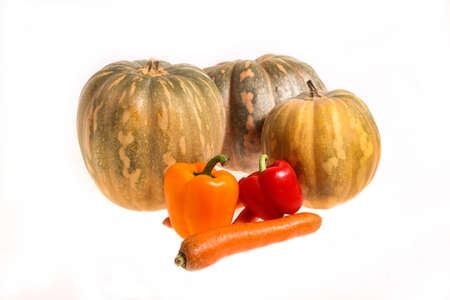 Pumpkins and other vegetables on a white background, isolated  photo