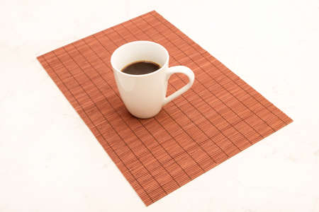 steamy: A steamy cup of coffee on a placemat  Stock Photo